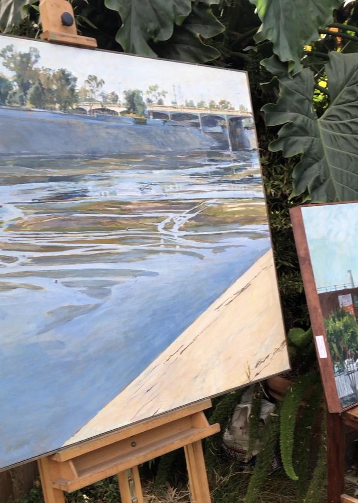 Joseph Corso's landscape paintings displayed in his backyard.
