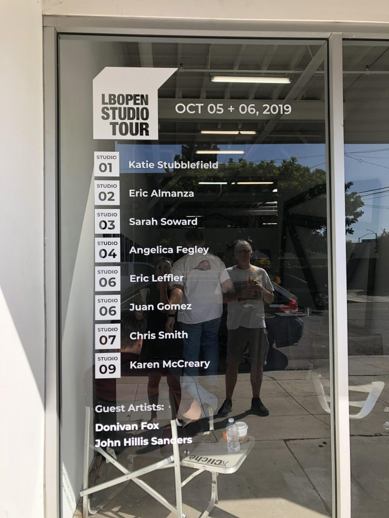 The front window of the Artist Co-Op Studios building with all the participating artists of the LBOST.