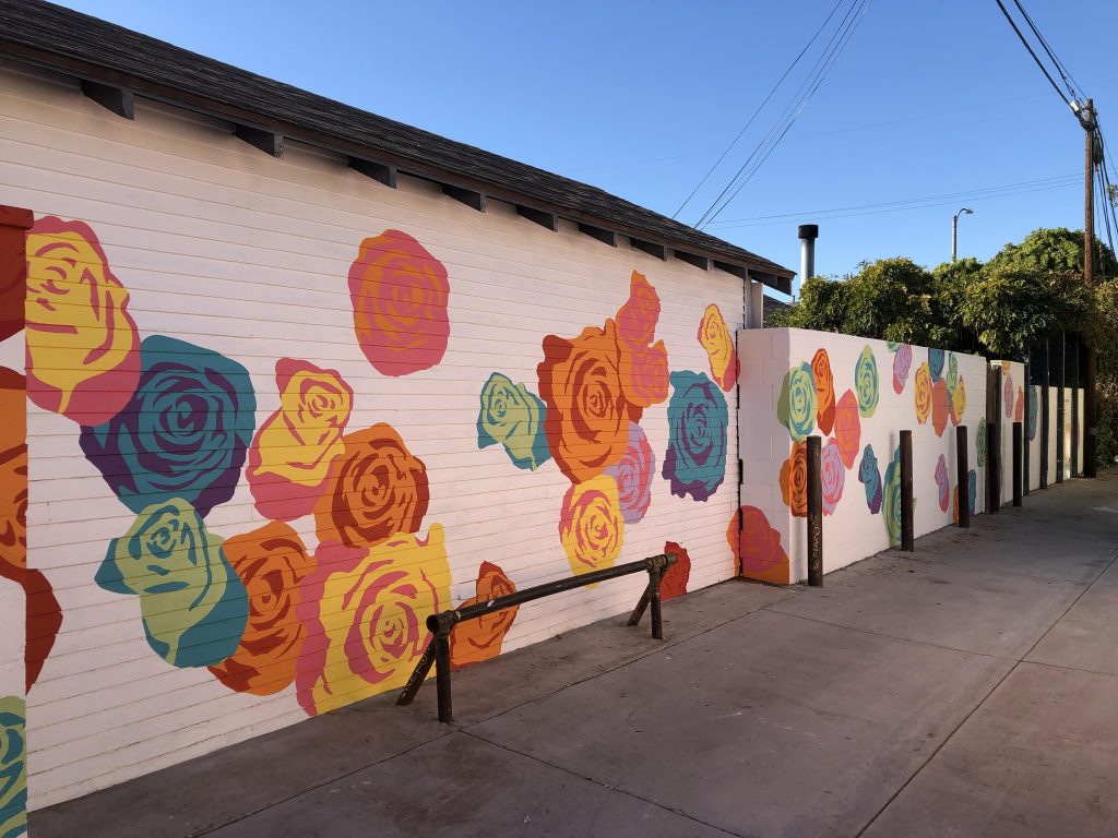 The Roses of Rose Park alley mural by Cody Lusby's studio.